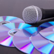 Vocal microphone on cd discs — Stock Photo #5884173