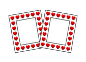 Two photo frames with hearts on white — Stock Photo
