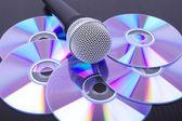 Microphone on cd discs — Stock Photo