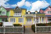 Wooden houses painted in Caribbean colors in Samana resort — Stock Photo
