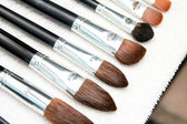 Professional make up brushes dry on towel — Stock Photo