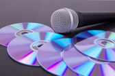 Vocal microphone on cd discs — Stock Photo