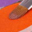 Professional make-up brush on orange eyeshadows palette — Stockfoto