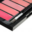 Lipgloss palette with brush — Stock Photo