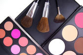 Make-up corrector with brushes — Stock Photo