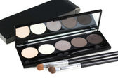 Make-up eyeshadows and two make-up brushes — Стоковое фото