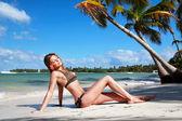 Woman in bikini on caribbean beach — Stock Photo