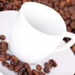 Cup in coffee beans — Stock Photo