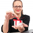 Royalty-Free Stock Photo: Surprised businesswoman with present box in hand