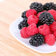 Royalty-Free Stock Photo: Blackberry and raspberries on white plate