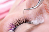 Making artificial long color lashes — Stock Photo