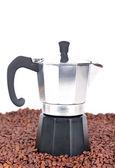 Coffeepot on coffee beans — 图库照片