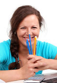 Happy girl with pens and pencils in hands — Stock Photo
