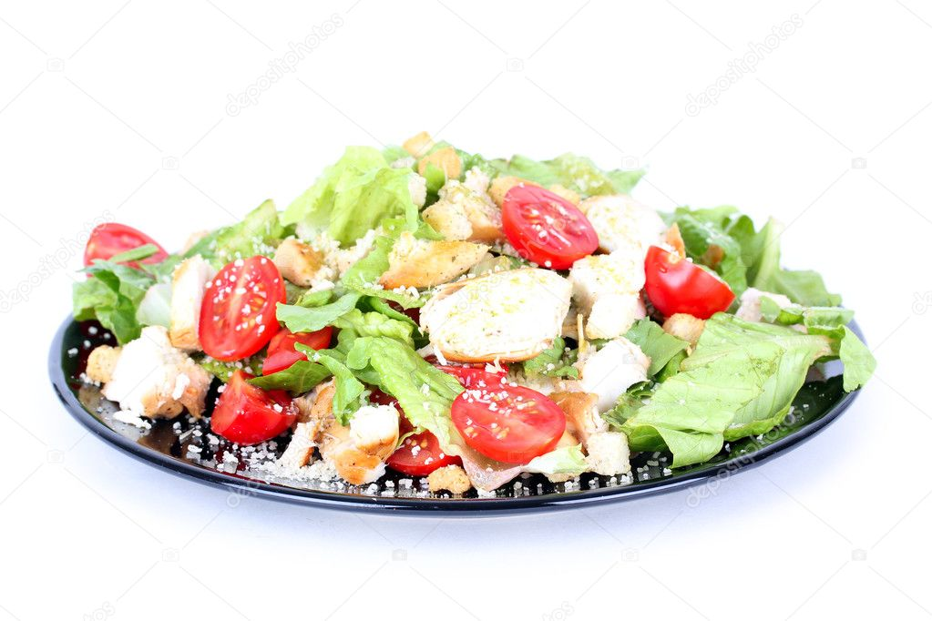 Caesar salad on black plate isolated on white — Stock Photo #6267933