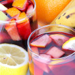 Sangria in glasses and fruits on table — Stock Photo