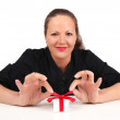 Smiling womwith present box in hands — Stock Photo #6631282