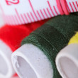 Threads bobbins and measurement tape - Zdjęcie stockowe