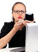 Businesswoman with red lipstick and mirror — Stock Photo