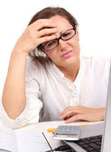 Unhappy businesswoman in office — Stock Photo