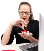 Surprised businesswoman with open mouth, with present box in han — Stock Photo