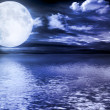 Stock Photo: Full moon reflected in water