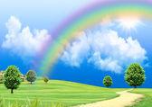 彩虹在绿色的林间空地 — 图库照片