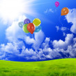 Stock Photo: Color balloons in dark blue sky