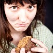 Beggar with a piece of bread — Stock Photo