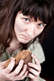 Beggar woman with a piece of bread — Stock Photo
