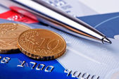Credit cards and coins with a ball pen. — Stock Photo