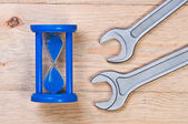 Hourglass wrenches on wooden background. — Stock Photo