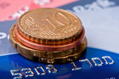 Credit cards and heap coins close up. — Stock Photo