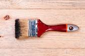 Brush on wooden background. — Stock Photo