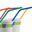 Paper disposable cups with colored tubes. — Stock Photo