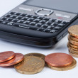 Stock Photo: Mobile phone with coins closeup.