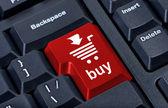 Počítač červené tlačítko Koupit s vozíkem, internetové obchodní koncept. — Stock fotografie