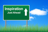 Inspiration road sign on sky background, grass underneath. — Stockfoto