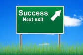 Success next exit road sign on sky background. — Stock Photo