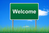 Welcome, concept road sign on sky background. — Stock Photo