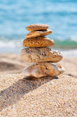 Stones in the sand close up. — Stock Photo