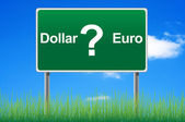 Dollar or euro, concept road sign on sky background. — Stock Photo