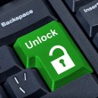 Button keypad unlock with padlock icon. - Stock Photo