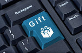 Button keypad with gift box icon. — Stock Photo