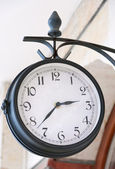 Analog clock outdoors close up. — Stock Photo