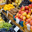 Fruit at market with price tags for sale. — Stock Photo