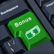 Button keypad bonus with money symbol. — Stock Photo