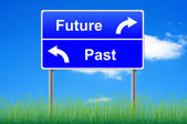 Future past conceptual signpost on sky background. — Stock Photo