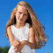 Cute little girl with blond long hair outdoor portrait in front — Stock Photo #5382209