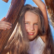Cute little girl with blond long hair playing on wooden chain sw — Stock Photo #5382261