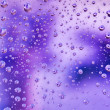 Stock Photo: Abstract translucent water drops background, macro view